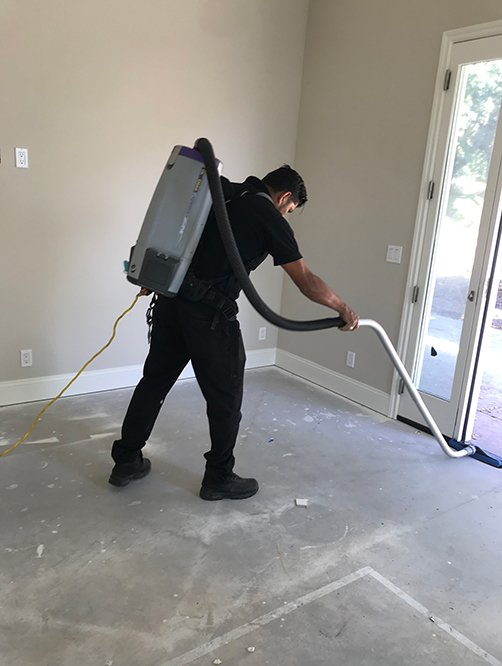 cleaner working in post construction cleaning project